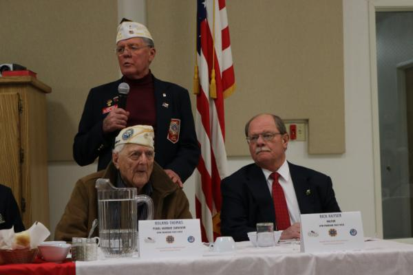 Post Commander Winkler with his hand on Guest of Honor Roland Thomas, joined by Cheyenne Mayor and Guest Speaker Rick Kaysen. It is believed that Roland is the last survivor of the Pearl Harbor attack who is still living in Laramie County.
